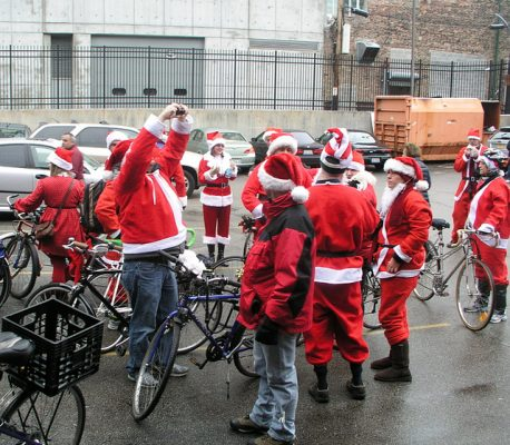 Santas on bikes, winter in Chicago. Photo by by Dubi Kaufmann,
