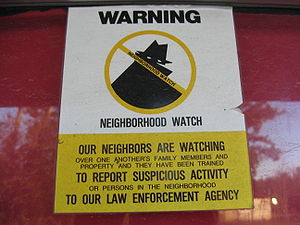 English: A neighborhood watch sign attached to...