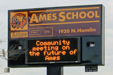An Ames Middle School sign announces a community meeting about converting the school to a military. Photo Credit: DNA Info