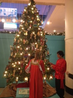 Engstrom Clugg's children decorate their Russian tree while dressed in traditional Christmas garments.
